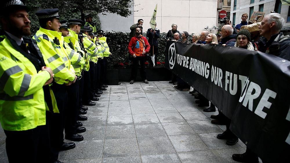 London police below fireplace after banning Extinction Rise up climate protests