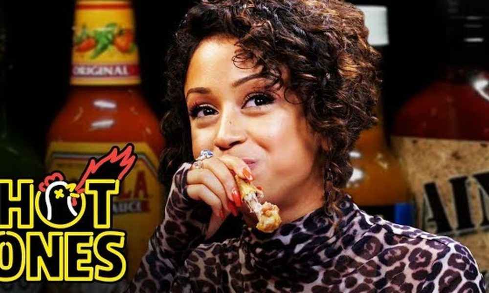 Liza Koshy talks celeb encounters while drinking bright wings on 'Sizzling Ones'