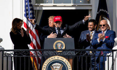 Trump Embraces Washington's Champions, Figuratively and Actually