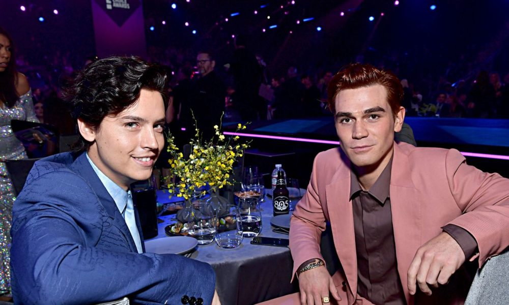 Why Did KJ Apa Promote Cole Sprouse's Extinct Under-Explore Masks To Joe Keery?