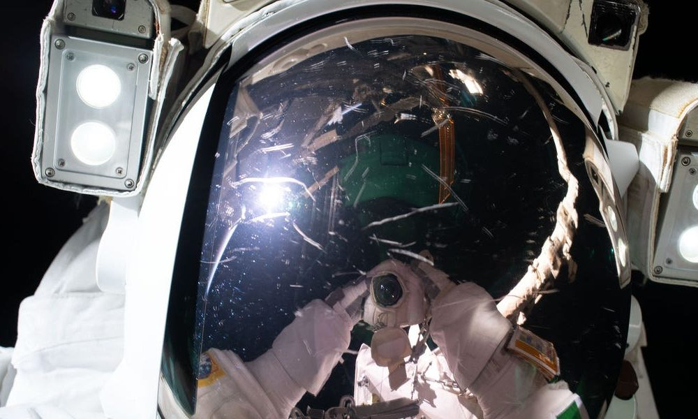 An Italian astronaut snapped an comely interstellar selfie while floating in position